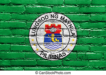 Flag of Manila, Philippines, painted on brick wall