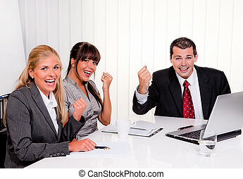 A successful team at a meeting in the office