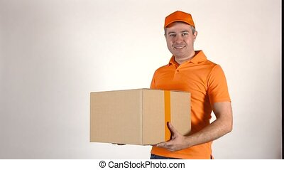 Delivery man in orange uniform delivering a big box. Light gray backround, 4K studio shot