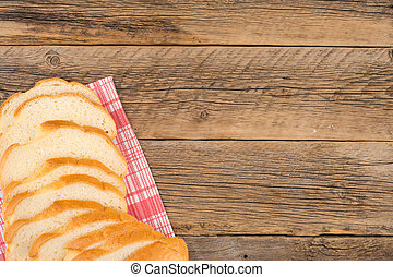 Loaf of bread on a wooden table.
