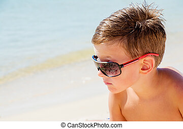 young happy trendy with sun glasses over summer blue sea