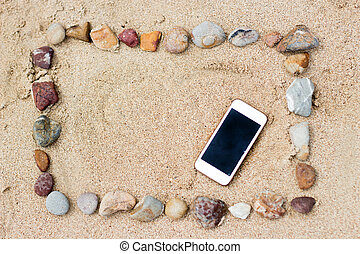 stone frame on beach and mobile - arranging stone on sand...