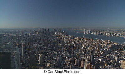 pan shot sun coming over manhattan - pan shot from above...