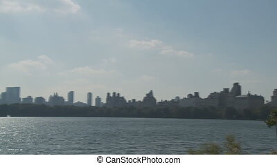 pan shot lake central park - pan shot over lake in central...