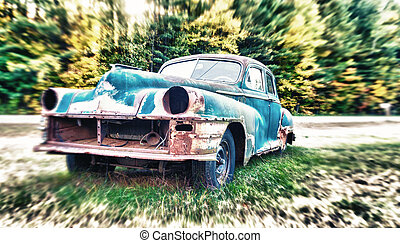 Old car wreck on a field.