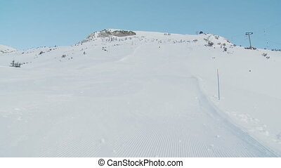 carving on ski piste in the morning - woman carving on empty...