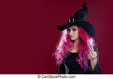 Attractive woman in witches hat and costume with red hair....