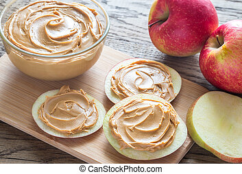 Slices of apples with peanut butter