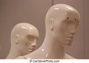 Mannequins and Models In Store. - Shop mannequins against a...