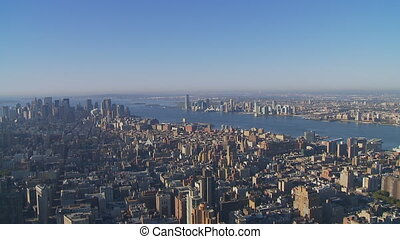 morning over manhattan pan shot - pan shot from above over...