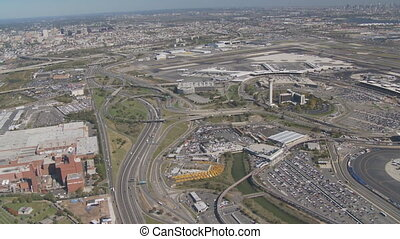 aerial view over streets and airport - aerial view newark...