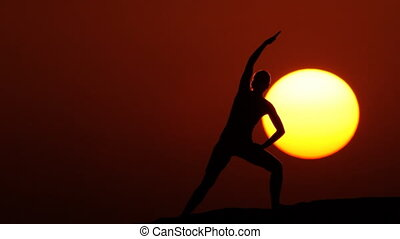 woman doing gymnastics at sunset huge sun 2.mov