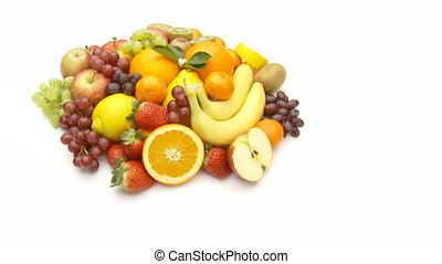larger pile of fruits - many different fruits on heap on...