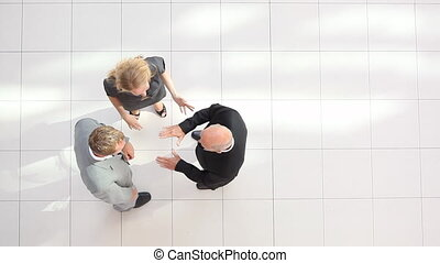 happy businessteam - topview of three happy business people...