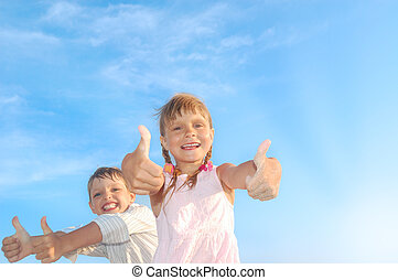 happy kids - happy 5-6 year old boy and girl with their...