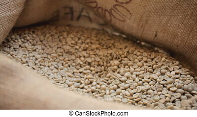 raw coffee with scoop - raw coffe beans in jute bag with...