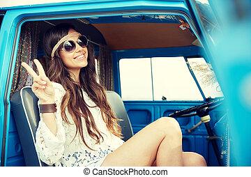 happy hippie woman showing peace in minivan car - summer...