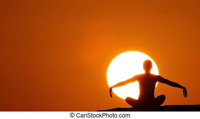 woman making yoga at sunset huge sun.mov
