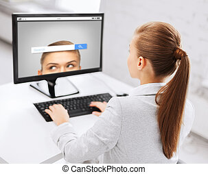 businesswoman with internet search on computer