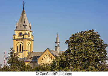 Old cathedral surrounded by trees in Ivano-Frankivsk city