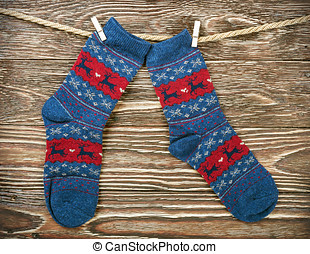 Christmas socks hanging on the wooden background
