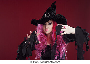 Attractive woman in witches hat and costume with red hair...