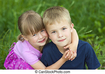 Children brother and sister hugging each other