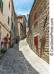 old street with flowers in Italy