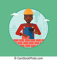 Bricklayer with spatula and brick. - African-american...