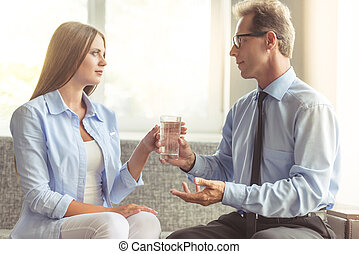 Woman at the psychotherapist - Beautiful young woman in...