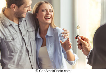 Couple buying new apartment - Handsome realtor in classic...