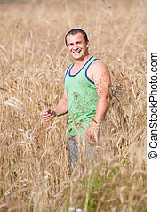 Young farmer in his wheat field