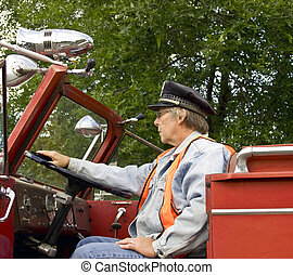 firefighter and firetruck - firefighter sitting in a vintage...