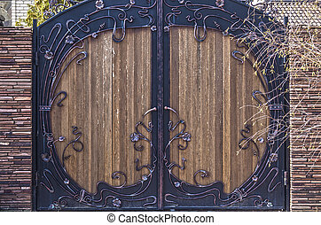 Old wooden gate in the street close up