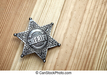 sheriff star on wood table closeup