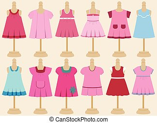 Set of baby dresses on mannequins - Set of childrens dresses...