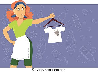 Stain removing - Upset woman looking at a kids tee-shirt...