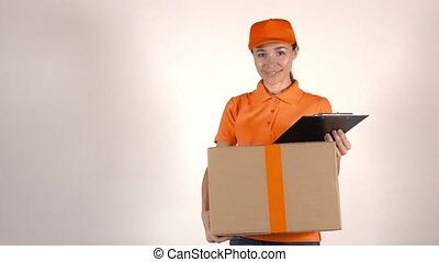 Girl courier in orange uniform delivering a big carton....
