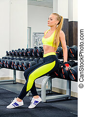 gym equipment - Slender young woman with beautiful athletic...