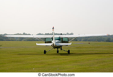 Cessna-172 on the parking - White Cessna-172 plane standing...
