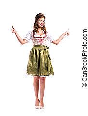 Beautiful woman in traditional bavarian dress, studio shot, isol