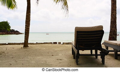 Tropical landscape view with deckchairs, Seychelles -...