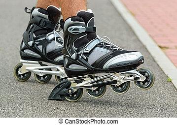 Roller blading legs - Roller blading outdoors, male legs