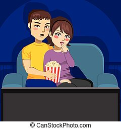 Couple Watching TV At Night