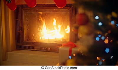 Background with decorated Christmas tree and burning...