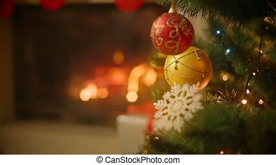 Closeup image of beautiful decorated Christmas tree in front...
