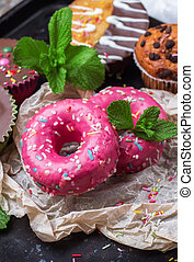 Colorful pink donuts on a grunge rusty table