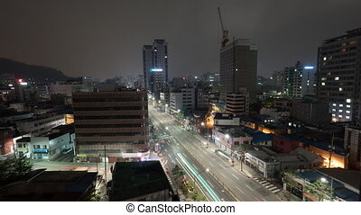 Timelapse of night Seoul with cars on motorway, South Korea...