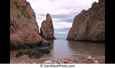 Stony beach in Tossa de Mar. Mediterranean sea, Spain. -...