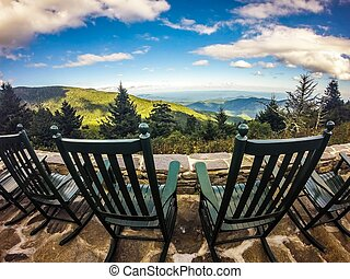 chairs with top of the mountain view